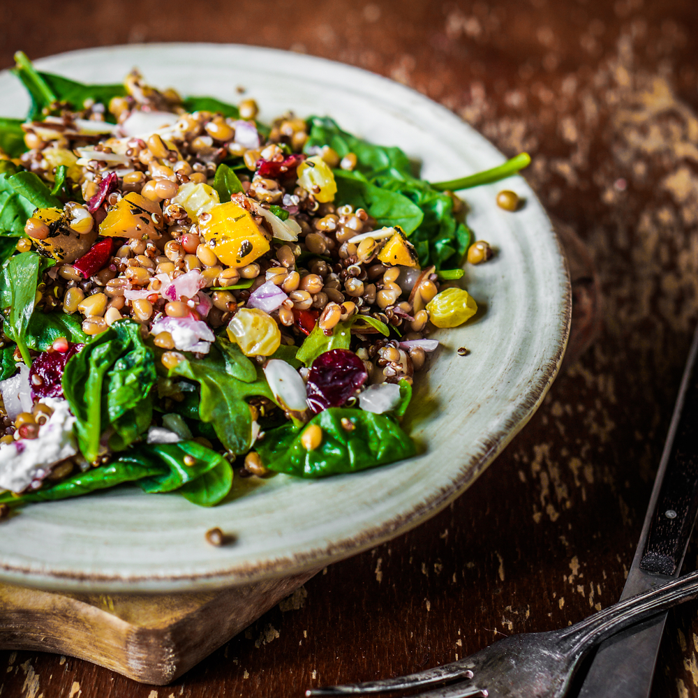 Healthy salad with farro, spinach and lentils