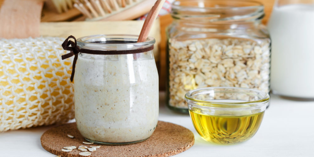 Homemade oatmeal mask in a glass jar. Gentle scrub for sensitive
